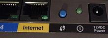 220px-Cisco_router_WPS_button